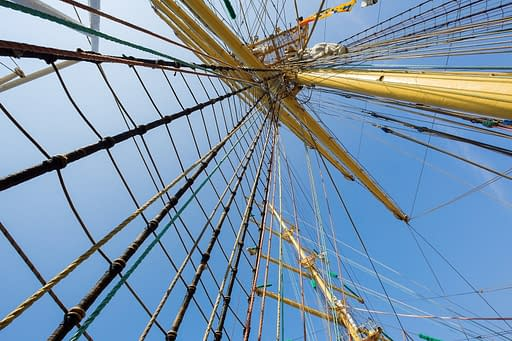 Rigging and masts of an old large sailing ship. This serves to explain how tension is seen in Rolfing fascia therapy.